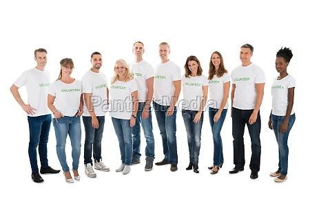 portrait of confident volunteers standing in