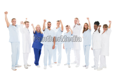 multiethnic medical team standing with arms