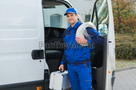confident technician with cable coil and