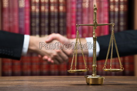 justice scale on table with judge