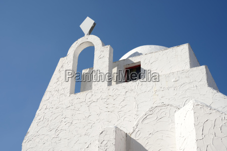 top of traditional white plaster building