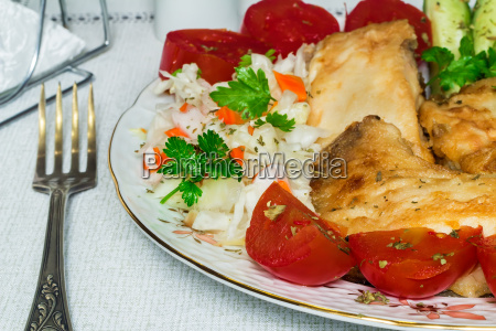 baked fish and vegetables on the