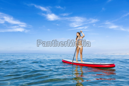 woman practicing paddle