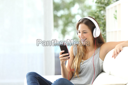 happy girl listening to music from