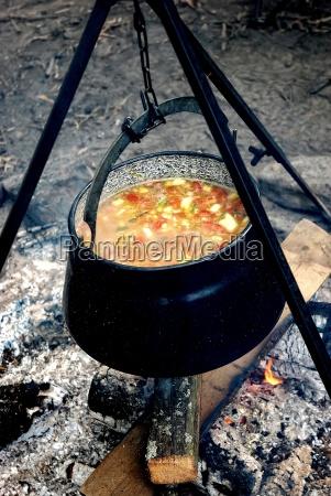 iron cauldron with vegetables soup