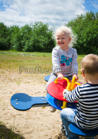 boy, and, girl, swinging, on, a - 15786412