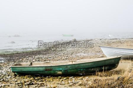 old, fishing, boat, at, coast, foggy - 15786368