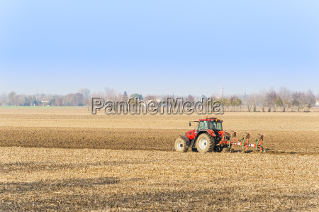 red, tractor, plowing, in, autumn. - 15786856