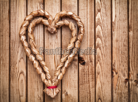 handmade heart on wooden background