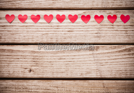 multiple small red hearts on wooden
