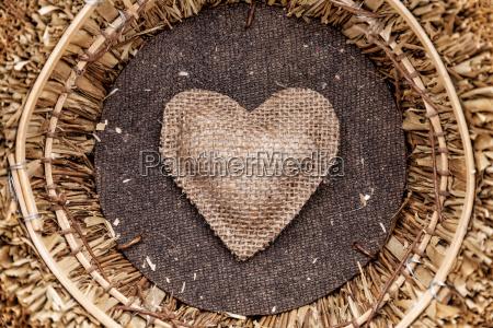 a single heart inside a basket