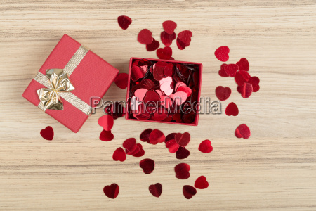 red, hearts, confetti, on, wooden, background - 15788664