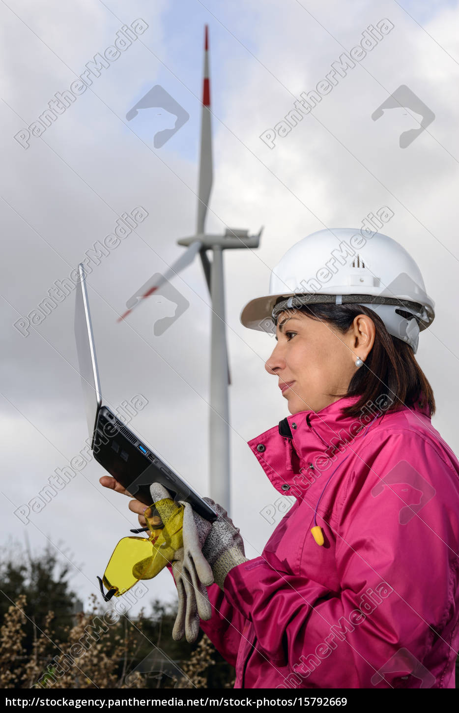 woman, engineer, checking, wind, turbines. - 15792669