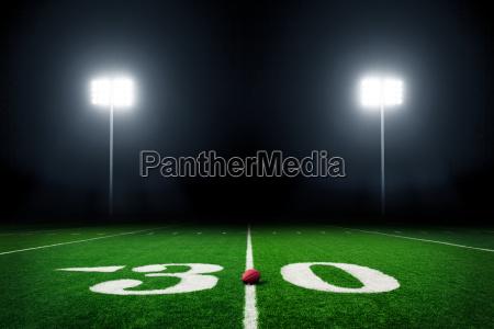football, field, illuminated, by, stadium, lights - 15794751