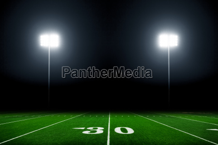 football, field, illuminated, by, stadium, lights - 15794753