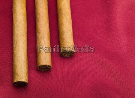 three, cigars, on, red, satin, three, cigars - 15794489