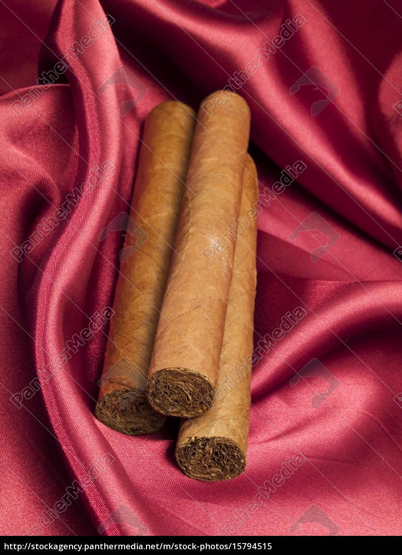 three, cigars, on, red, satin, three, cigars - 15794515