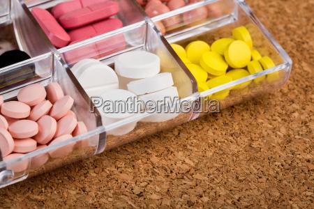 various pills in plastic container