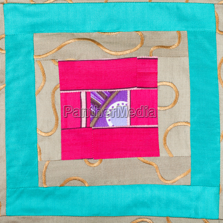 square decor of patchwork cloth