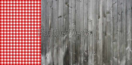gray wooden boards with tablecloth red