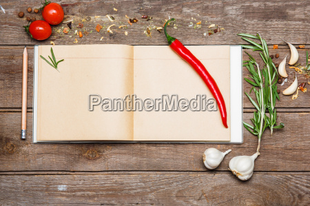 open blank recipe book on brown