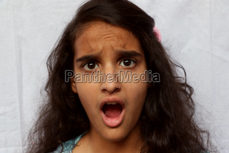portrait of a surprised girl child