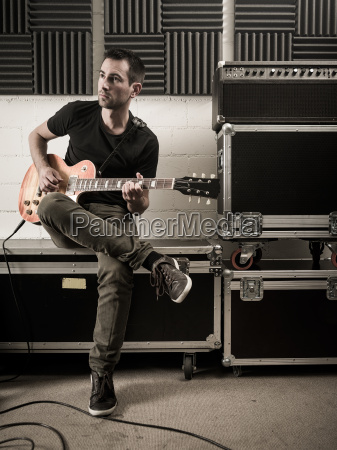 guitar playing in the studio