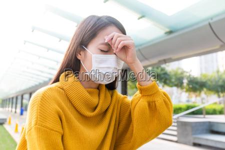 woman got serious headache and wear