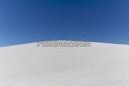 snow field with blue sky copy