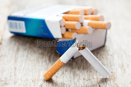 broken cigarette and full package