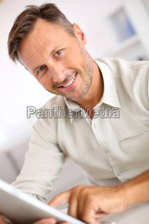 handsome guy websurfing on internet with
