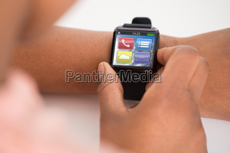 persons hand wearing smartwatch