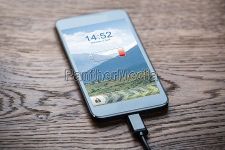 smart phone connected to charger on