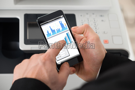 businessman giving print command on smart
