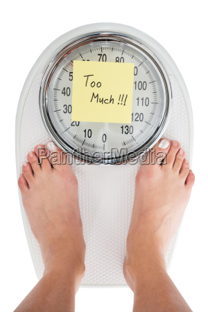 woman standing on weight scale with