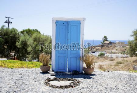 exterior door ajar blue and