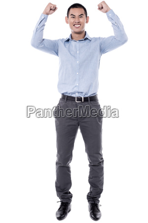 cheering young man against a white