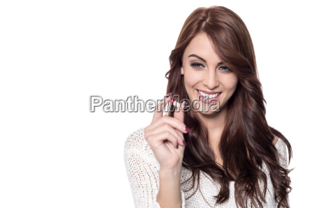 young woman holding pill for ache