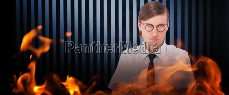composite image of geeky businessman looking
