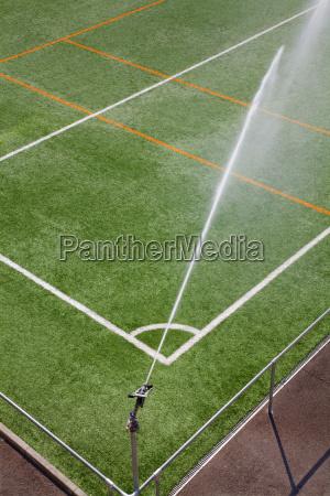 irrigation sprinkler system working at sport