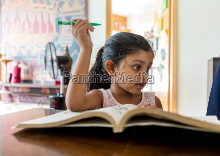 indian girl reading book at home
