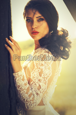 attractive brunette woman in lace dress