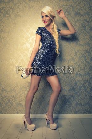 attractive blonde woman in short pailette