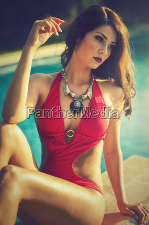 attractive brunette woman in a red