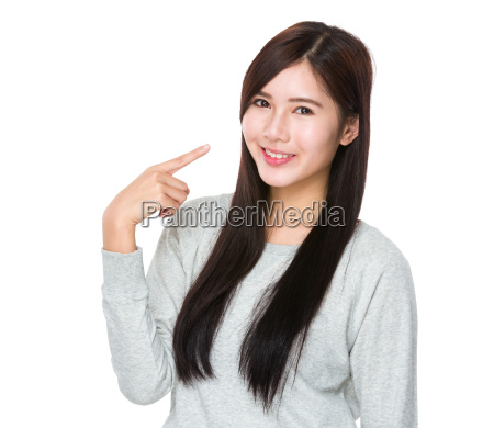 asian young woman with finger point
