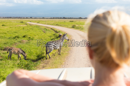 woman on african wildlife safari