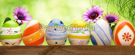 easter eggs against light green background
