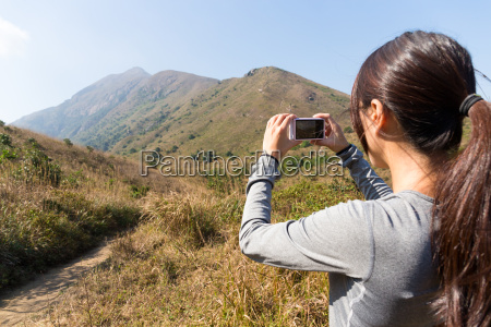 woman use of the digital camera