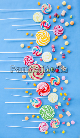 colorful lollipops on blue