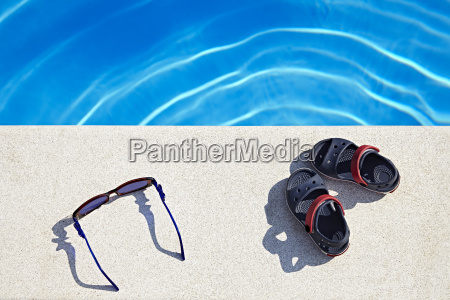 sunglasses and sandals at the swimming